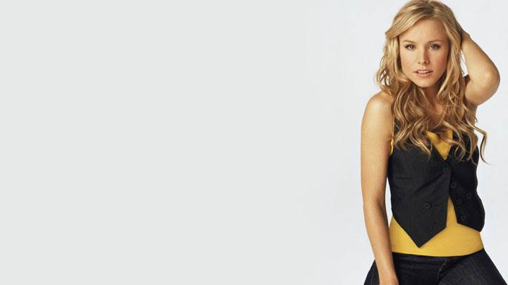 Kristen Bell Sitting Pose In Black Dress And White Background