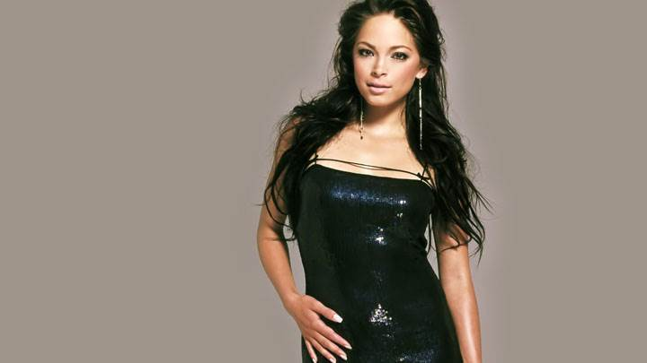 Kristin Kreuk Looking Front In Black Dress Photoshoot