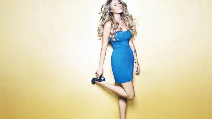 Lauren Conrad Smiling In Blue Dress And Golden Background