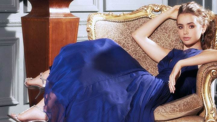 Lily Collins Sweet Face In Blue Long Dress Sitting Pose