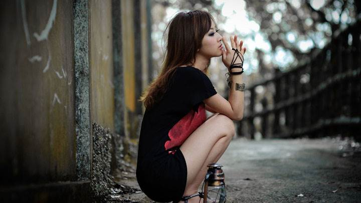Asian Girl Sitting Pose Outside Metro Station