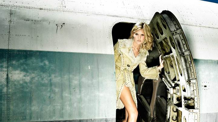 Maggie Grace In Coat Photoshoot At Plane Door