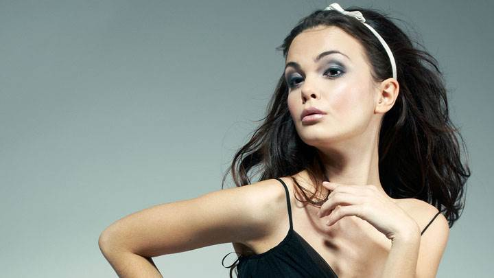 Model Poses In Black Dress Side Face Photoshoot