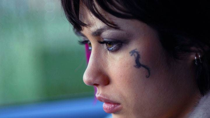 Olga Kurylenko Tatoo On Side Face Closeup