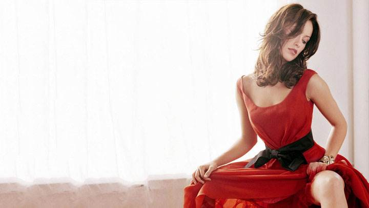 Olivia Wilde In Long Red Dress Sitting Pose