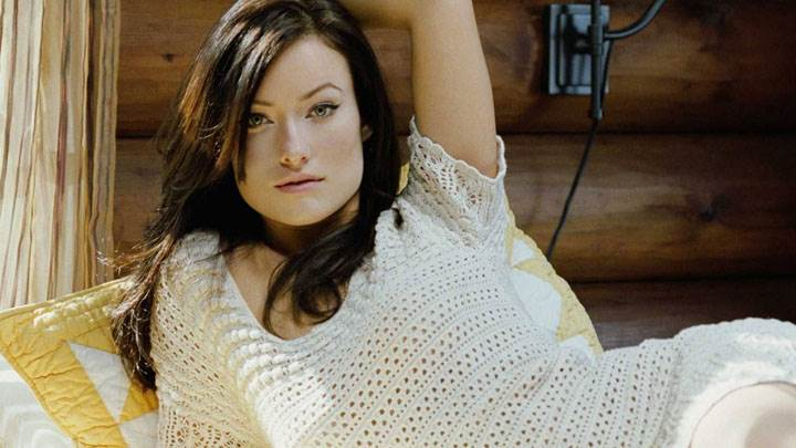 Olivia Wilde Laying Pose On Bed In White Dress
