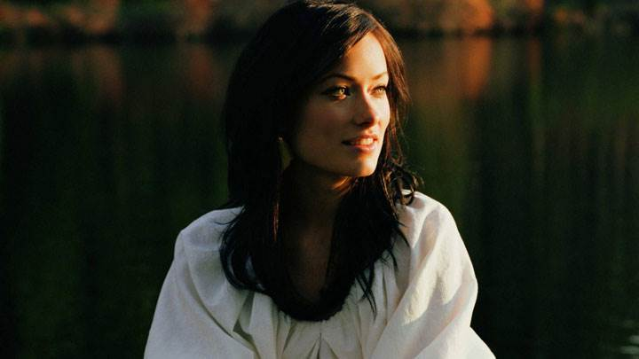 Olivia Wilde Smiling In White Top Side Face In Sunset Time