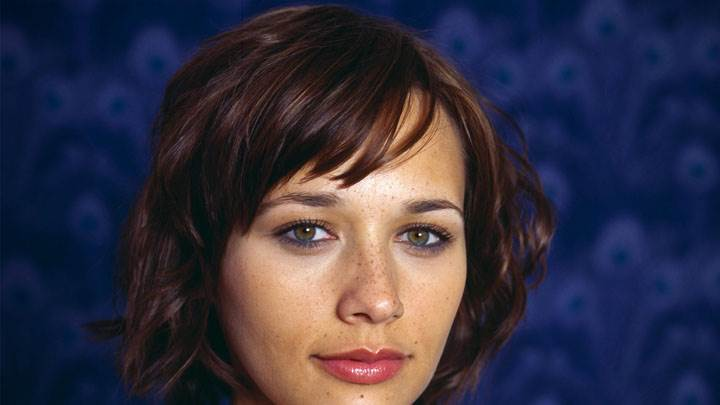 Rashida Jones Smiling Pink Lips And Blue Background Face Closeup