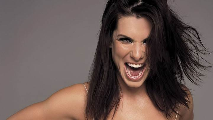 Sandra Bullock Laughing And Grey Background