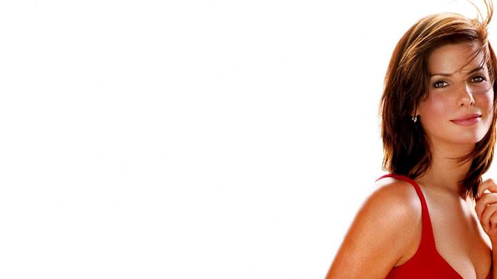 Sandra Bullock Smiling In Red Top And White Background