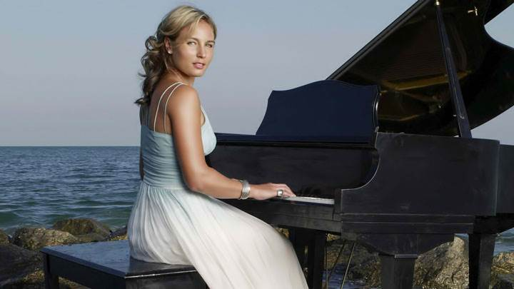 Severine Bremond Beltrame Hands On Piano In Long Dress Sitting Pose