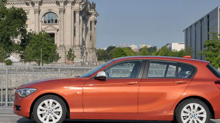 Side Pose of 2012 BMW 1-Series in Orange