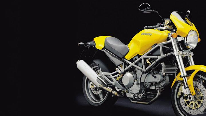Side Pose of Ducati monster 1000 s 2004 in Yellow And Black Background