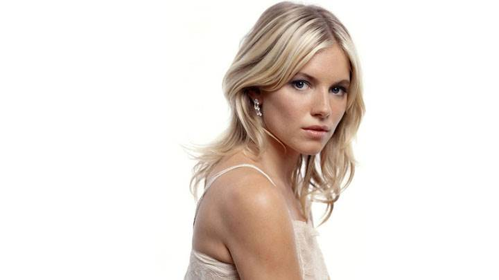 Sienna Miller Looking Front Side Pose In White Dress And White Background