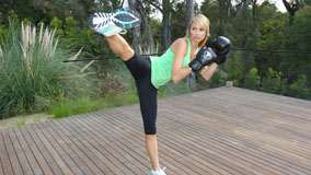 Stacy Keibler Bohing Gloves On Hand And Doing Exercise