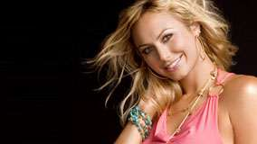 Stacy Keibler Smiling In Pink Top And Black Background