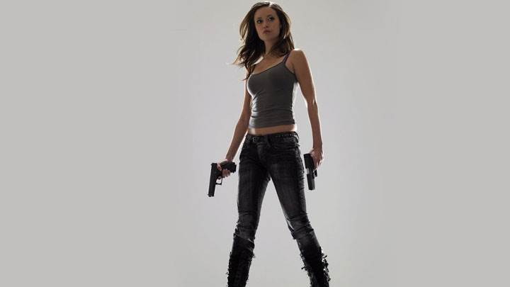 Summer Glau Guns In Hands Photoshoot