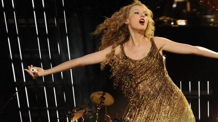 Taylor Swift In Golden Dress Singing A Song