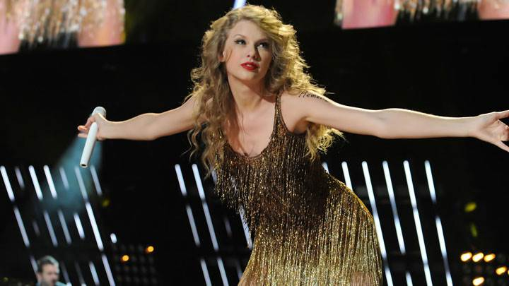 Taylor Swift Mic In Hand In Golden Dress