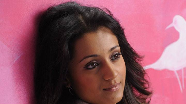 Trisha Krishnan Smiling Face And Pink Background