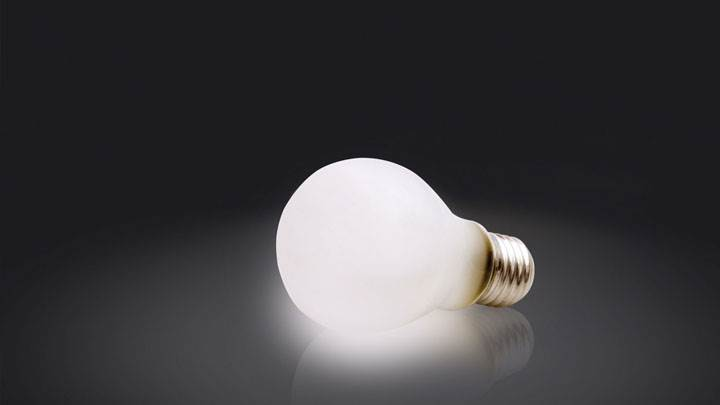 White Single Bulb On Black Background