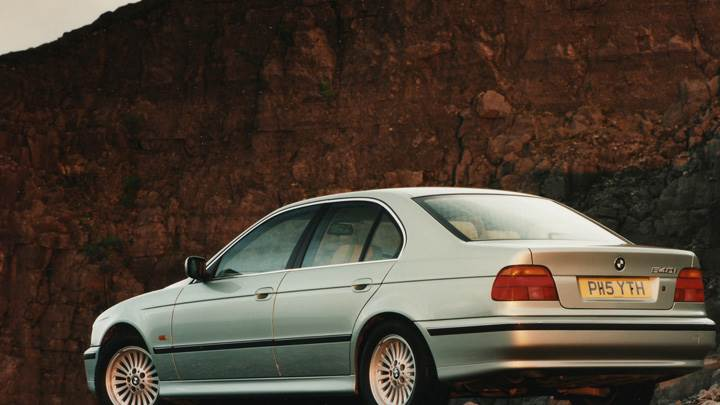 1996 BMW 540i Side Back Pose Near Moutains