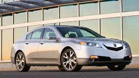 2009 Acura TL SH-AWD Side Front Pose In Silver