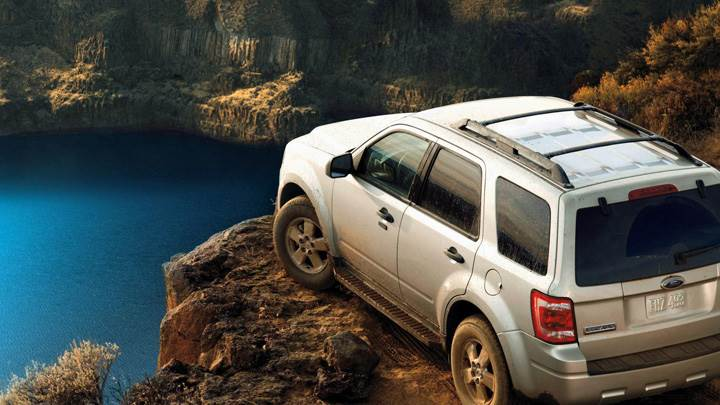 2009 Ford Escape Near River In Metalic Silver