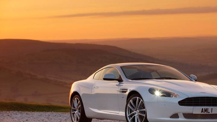 2010 Aston Martin DB9 Near Mountains Front Pose N HeadLights On