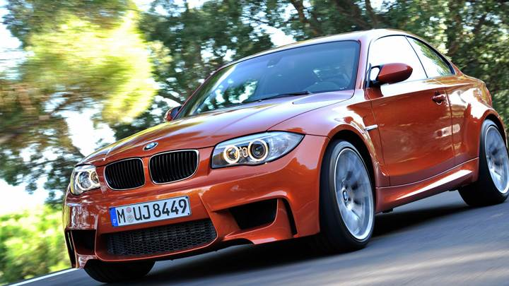2011 BMW 1 Series M Running on Road in Orange