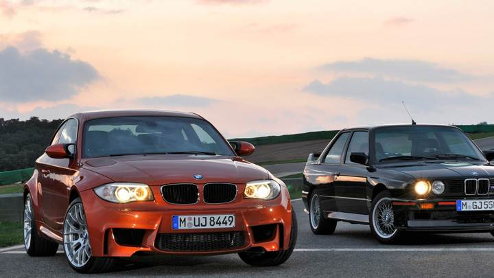 2011 BMW 1 Series M Orange Vs Black Car And Headlights On