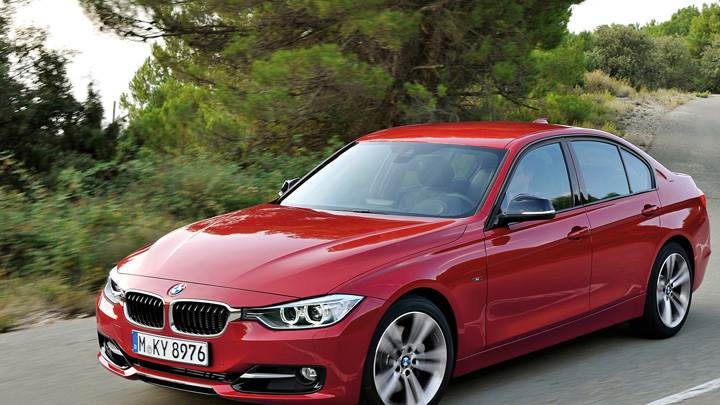2012 Bmw 3 Series Sedan F30 Front Side Pose In Red Wallpaper