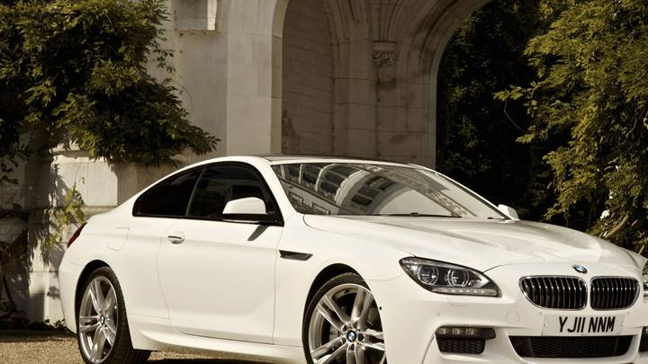 2012 BMW 6 Series Coupe Side Front Pose in White