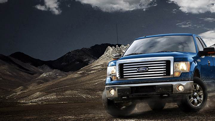 2012 Ford F-150 in Blue Near Mountains