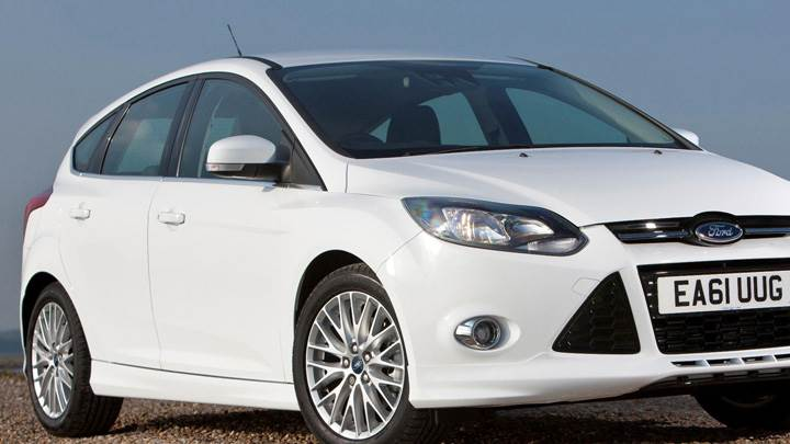 2012 Ford Focus Zetec S Side Front Pose In White