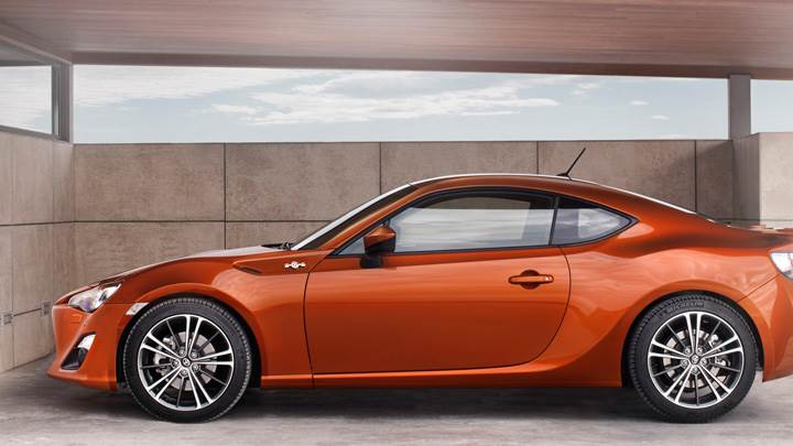 2012 Toyota GT 86 In Orange Side Pose In Garage