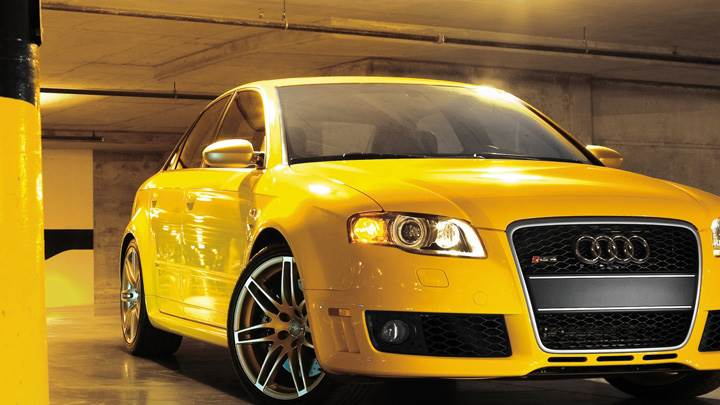 Audi RS4 Cabriolet Front Pose In Yellow In Garage