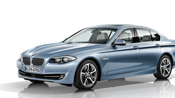 BMW ActiveHybrid 5 In Blue N White Background