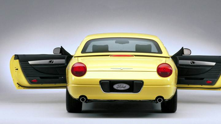 Back Pose Of 2002 Ford Thunderbird In Yellow N Door Open