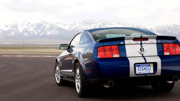 Back Pose Of 2008 Ford Shelby GT500KR In Blue On Race Course
