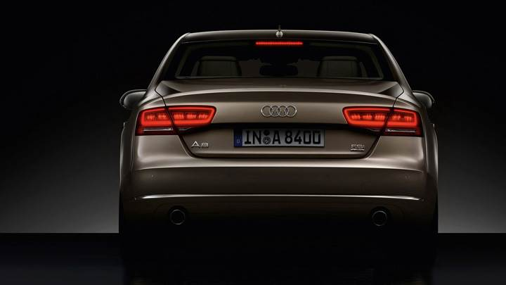 Back Pose Of 2011 Audi A8 In Brown