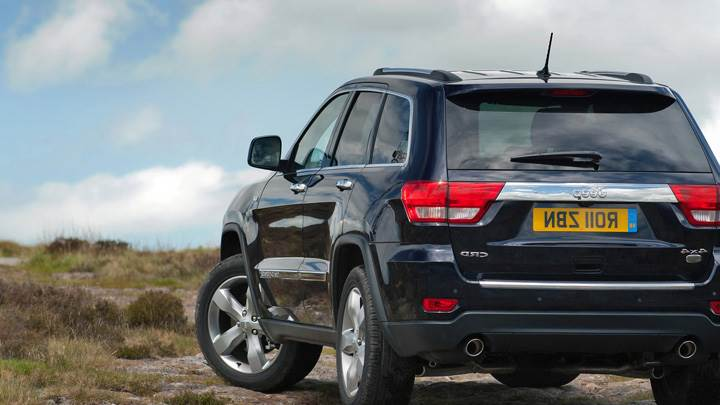 Back Pose Of 2011 Jeep Grand Cherokee in Black