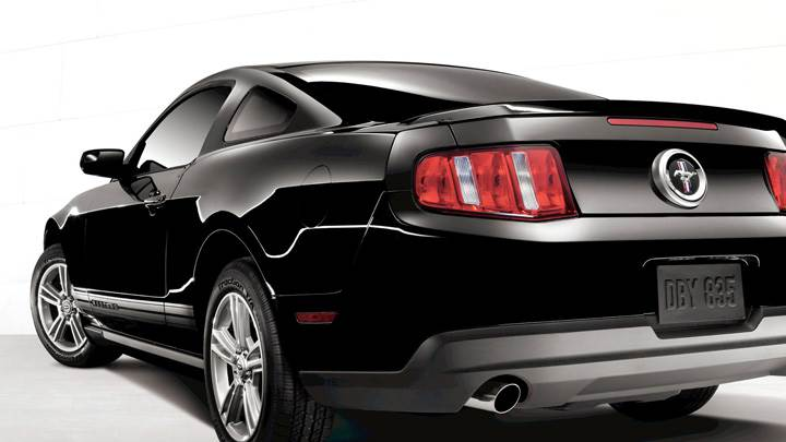 Back Side Pose Of 2011 Ford Mustang V6 In Black