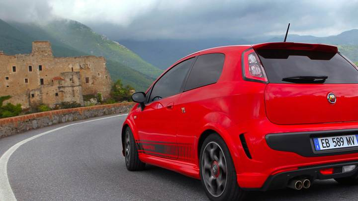 Back Side Pose Of 2010 Abarth Punto Evo In Red