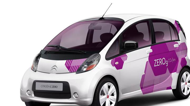 Citroen C-Zero Front Side Pose In White N Purple Designing