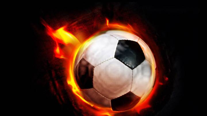 Football In Fire And Black Background