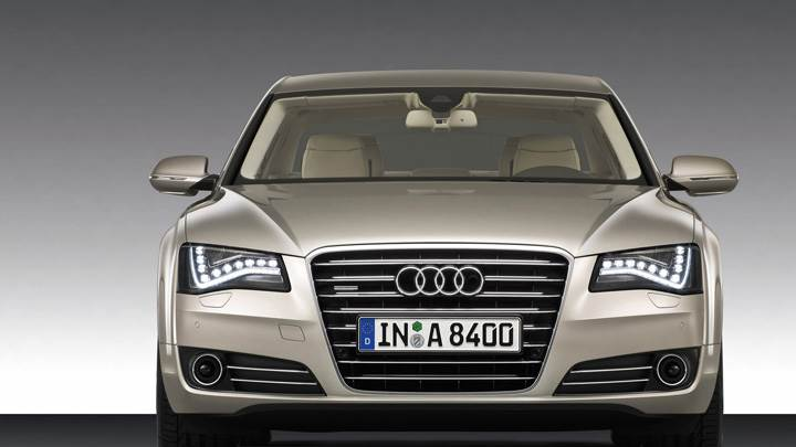 Front Pose Of 2011 Audi A8 In Golden