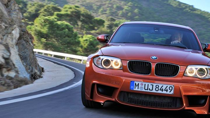 Front Pose Of 2011 BMW 1 Series M Running in Orange