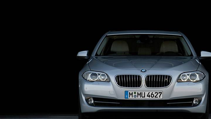 Front Pose Of 2011 BMW 5-Series Sedan In Grey