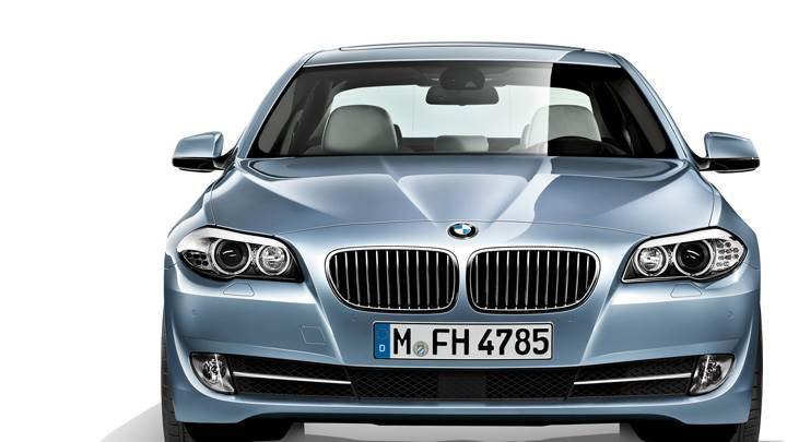 Front Pose of 2012 BMW ActiveHybrid 5 In Blue